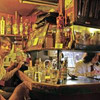 Drinking den: Namazu's cramped bar seats just five patrons, but outside seating accommodates around nine more. The bar is a favorite among bohemian Shimokitazawa's many musicians.