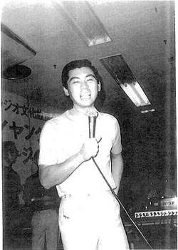 Stage struck: The star-to-be gives voice during an impromptu performance before he became the icon of Japanese TV he has now been for so long. | NIKKOKU LTD.