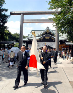 Above, top to bottom: The  Hinomaru  on show at Yasukuni Shrine in Tokyo to mark the war's-end anniversary on Aug. 15, 2008; Tokyo rightists with their insignia- emblazoned 'sound truck'; and a self-portrait of the late 18th-century Japan supremicist Motoori Norinaga. | YOSHIAKI MIURA PHOTO