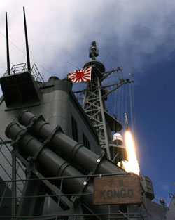 Naval emblem: The Japanese destroyer Kongo, flying the Maritime Self-Defence Force's rising sun flag with 16 rays, launches a missile off Hawaii in December 2007. | AP PHOTO