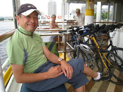 Down time: 'Tokyo Great Cycling Tour' guide Carlos takes a short break during a boat ride across Tokyo Bay. | TOMOKO OTAKE PHOTO
