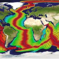 Oceans of data: This map, using radiometric data compiled by the U.S. National Oceanic and Atmospheric Administration, illustrates the process by which the ocean floors have been created within the last 200 million years. Pink and red indicate the most recent additions; greens followed by blues are the oldest. Detail added by researcher Neal Adams' Continuity Associates breaks the growth into 10-million-year sections. Humans have existed on Earth only during the time indicated by the pink lines. | NOAA / CONTINUITY ASSOCIATES