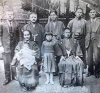 Family secrets: Members of the Miyagi family gathered in Nago, Okinawa, in 1937, during the spy Yotoku Miyagi's visit to his home town at the time of his father's 60th birthday. His niece, Toshiko Tokuyama, then aged 9, is in the center of the front row, between her grandfather, Yotoku's father, Yosei, and her grandmother, Kamado. Her uncle Yotoku, then already a key member of Sorge's spy ring for four years, is on the far right. The writing on the photo reads: 'In commemoration of the 60th birthday of Yosei Miyagi.' | TOSHIKO TOKUYAMA PHOTO