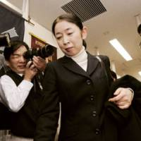 Muraki fields media questions in September 2010, days after her acquittal and as news of evidencetampering by prosecutors surfaced in a media report. | KYODO PHOTO