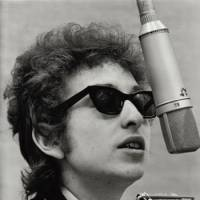 Changin' faces: Dylan in 1965 and on the set of 'Masked and Anonymous' (2003). | SONY MUSIC JAPAN INTERNATIONAL INC.