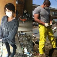 Helping hands: Nanako Hirano (left) cleans a house and Evgeny Latypov clears a ditch of mud and debris in Iwaki, Fukushima Prefecture, on May 21. | COURTESY OF EVEGENY LATYPOV