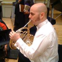 Jonathan Hammill plays the first horn during the filming of the movie 'Nodame Cantabile' at a concert hall in Bratislava, Slovakia, in June 2009. | COURTESY OF JONATHAN HAMMILL
