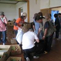 the volunteers hand donated vegetables to residents, who are still short of fresh produce.