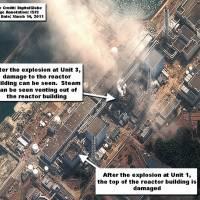 Shocking sights: Satoshi Kamata seen on April 26 (above) during a reporting trip he made to the tsunami-stricken town of Otsuchi in Iwate Prefecture. Right: A satellite photograph taken on March 14 of the crippled and leaking Fukushima No. 1 nuclear power plant. | KYODO PHOTO