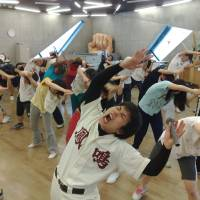 Letting it all hang out: Budding comedians in a popular 'dance' class at NSC Tokyo led by choreographer Lucky Ikeda learn how to lose their inhibitions.