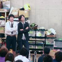 Hot stuff: Comedy duo Parthenon discuss some wacky ways to keep warm in winter, including smearing yourself with chilli sauce, during a recent class at NSC Tokyo.