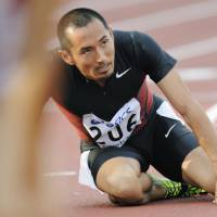 Life's downs and ups: Disappointment shows in Dai Tamesue's face after he finished 6th in the 400-meters hurdles at the 2011 Japan National Championships held in Kumagaya, Saitama Prefecture. | KYODO