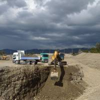 A former paddy field outside Matsumoto in Nagano Prefecture where gravel extraction is in full swing.   WINIFRED BIRD