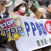 Half-in or half-out?: Japan's equivocation over whether to join the  Trans-Pacific Partnership negotiations is symptomatic of a general unease over opening up to the wider world, Chris Burgess argues. | AP