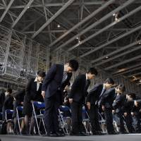 No longer peripheral: Nonpermanent employees, including part-timers, dispatch workers and shokutaku, now make up over one-third of Japan's workforce. | AP
