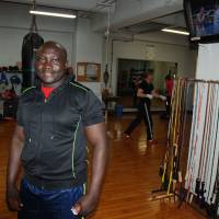Packing a punch: Geoffrey Ima, originally from Uganda, poses at the Chunichi Boxing Gym in Nagoya, where he works as a trainer. | STEPHEN CARR