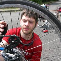 Day 13: Dylan Gunning replaces another broken spoke on Andrew Marston's rear wheel in Hiroshima. | ANDREW MARSTON