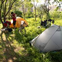 Day 33: Dylan Gunning camping in Joetsu, Niigata Prefecture, and wolfing down what is probably oatmeal. | ANDREW MARSTON