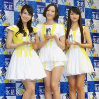 Freshman class: The members of Perfume pose with an alcoholic drink they are helping to sell. The concept of Japan's modern commercial musician came from a strategy pioneered in the 1980s by ad agency Dentsu. | KYODO PHOTO
