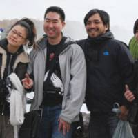 Right: Tanaka plays tour guide at Niagara Falls, Ontario, to the band Susquatch.