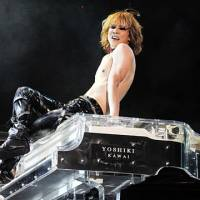 Sound and visual: X Japan cofounder Yoshiki sits atop his piano during a concert at Asia World Expo in Hong Kong on Nov. 4. The band pioneered a popular style of music called visual-kei in Japan. | AP PHOTO