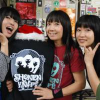 Knife or death: The current members of Shonen Knife (from left: Ritsuko Taneda, Naoko Yamano and Emi Morimoto) show off their gear after a Tokyo gig Dec. 2. | DANIEL ROBSON PHOTO