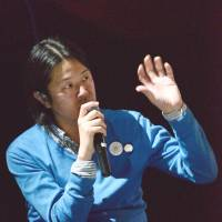 Beat banter: Masaaki Hara speaks at last month's 'Beacon in the City' event in Tokyo. | FUMIKA SENO