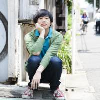 Homecoming: Dustin Wong visits Tokyo's Shimokitazawa neighborhood on Wednesday. The Hawaii-born musician spent a chunk of his youth in Tokyo and recently returned here to live. Wong has released a collaborative effort with singer Takako Minekawa titled 'Toropical Circle.' | CHIEKO KATO