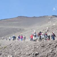 Mountain trek: Climbers descend from the top of Mount Fuji. | ANDREW LEE