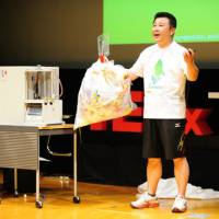 Plastic solutions: Akinori Ito, environmental problem-solver, and CEO of Blest Corporation, demonstrates his invention — a machine that can convert a kilogram of waste plastic into a liter of oil. | ANDY MCGOVERN/TEDXTOKYO2011
