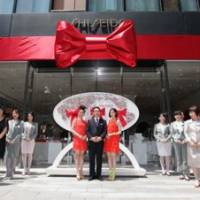Years of beauty: Model Emi Takei (left), and actress Kiko Mizuhara (right) and Shiseido President Hisayuki Suekawa attend the ribbon-cutting ceremony of Shiseido The Ginza in Tokyo on May 14.