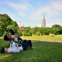 Shady lane: The grassy area in Meiji Jingu's northwest corner is a perfect place to relax. | JASON JENKINS