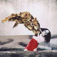 Watery grave: Onoe Kikunosuke, as Narumi Haruyoshi, fights the mythical golden shachihoko in a flooded river (Act IV).   COURTESY OF THE NATIONAL THEATER OF JAPAN