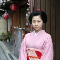 A passing maiko (trainee geisha) in Kyoto, who kindly let me take just the one photo.