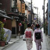 Two trainee geisha in a Kyoto street.