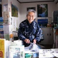 Rustic charms: Chieko Okuma in her cafe (try the cheesecake!) next to her Okuma Art Museum with its display of the Christmas plates made to a different design every year since 1898 by the Royal Copenhagan pottery.