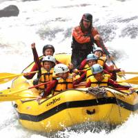 Young visitors shoot Tone River rapids with the Canyons outdoor adventure company.