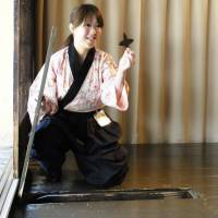 Iga-Ryu Ninja Museum staff variously show where Ninja weapons could be hidden under floorboards | MANDY BARTOK