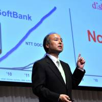 Counterpunch: Softbank President Masayoshi Son holds a press conference in Tokyo Tuesday. | AFP-JIJI