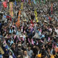 Workers hold May Day rally seeking higher pay, stability