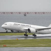 Back in the air: A JAL 787 Dreamliner takes off on a test flight at Haneda airport in Tokyo on Thursday morning. | KYODO