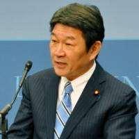 LNG appeal: Economy, Trade and Industry Minister Toshimitsu Motegi delivers a speech at a think tank forum in Washington on Friday. | KYODO
