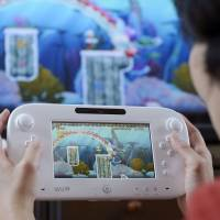 Moving to adapt: Nintendo Co. is trying to modify its Wii U videogame console so smartphone applications can be used on them. | BLOOMBERG