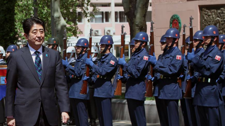 Economic detour: Prime Minister Shinzo Abe inspects a Turkish military honor guard in Ankara on Friday.   AP