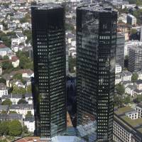 Towering: A view of the headquarters of Deutsche Bank AG in Frankfurt. | BLOOMBERG