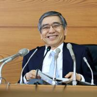Better times: Bank of Japan Gov. Haruhiko Kuroda holds a news conference in Tokyo on April 26. | BLOOMBERG