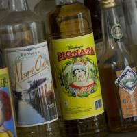 The cognac of Brazil: Bottles of cachaca, made from sugar-cane juice that is fermented and distilled, are displayed at the Luiz de Queiroz college of agriculture in Piracicaba, Brazil. | AFP-JIJI