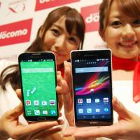 Phone home: Models show off NTT DoCoMo's new smartphone handsets in Tokyo's Chuo Ward on Wednesday. | KYODO