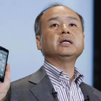 Bank on it: Masayoshi Son, president of Softbank Corp., introduces the company's Aquos Phone Xx 206SH smartphone during a product launch in Tokyo on May 7. | BLOOMBERG