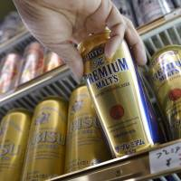Inviting: Cans of Suntory Holdings Ltd.'s Premium Malt's beer are shown at a liquor store in Kawasaki in January. | BLOOMBERG